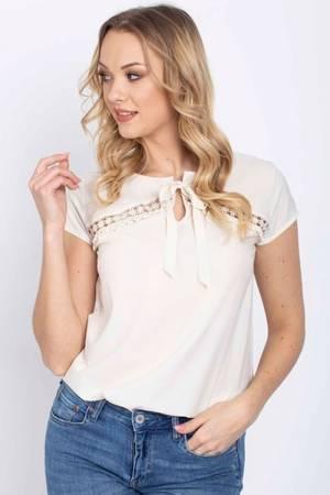 Beżowa bluzka z wiązaną kokardką - Odzież