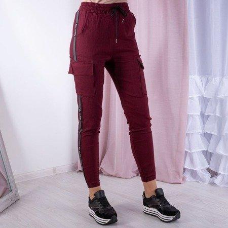 Bordowe spodnie cargo - Spodnie
