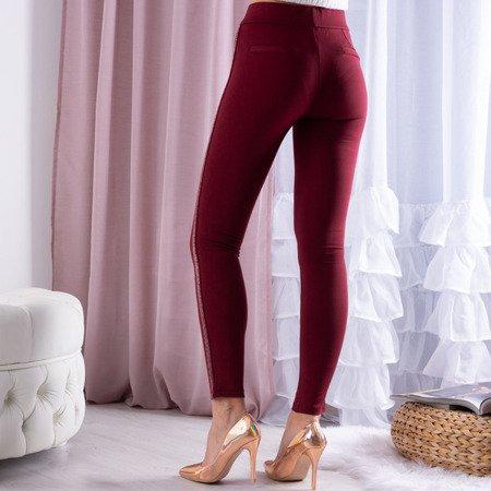 Bordowe tregginsy z brokatowymi paseczkami - Spodnie