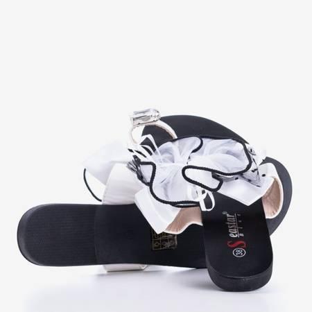 Czarno-białe klapki z kokardką Abima  - Obuwie