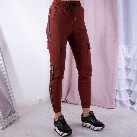 Czerwono-pomarańczowe spodnie cargo - Spodnie
