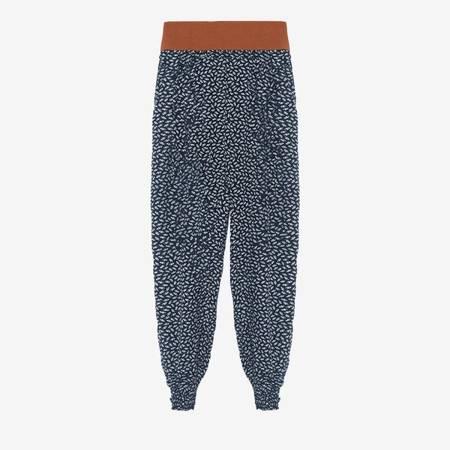 Granatowe spodnie alladynki w piórka - Odzież