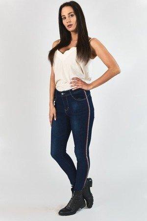 Granatowe spodnie jeansowe z lampasami - Odzież